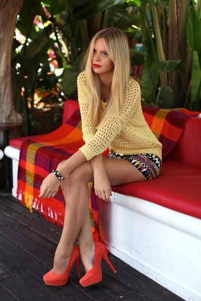 red velvet heels with a light orange sweater and printed mini skirt