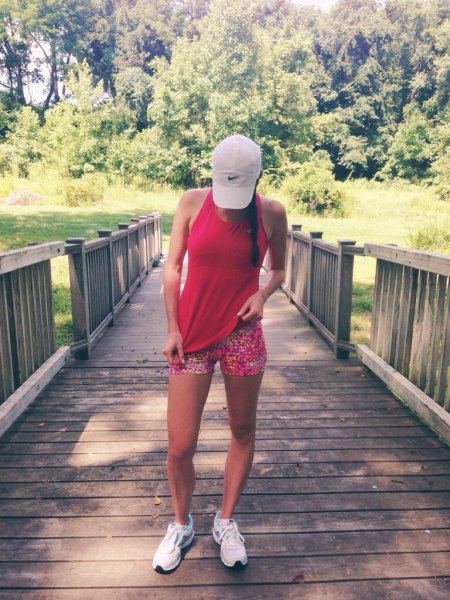 Red vest top with running shorts printed in rainbow colors