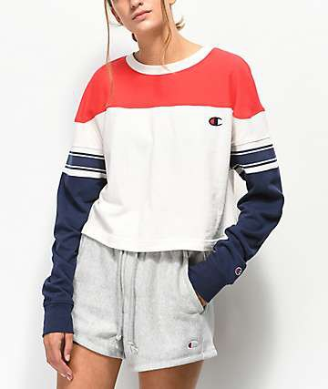 red, white and dark blue color block sweatshirt with gray shorts