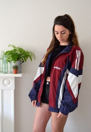 Red, white and navy blue vintage windbreaker with black mini denim shorts