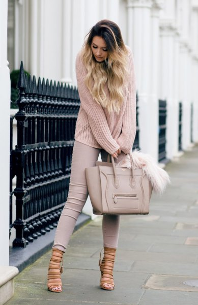 Ribbed light pink sweater with gray skinny jeans and blushing strappy heels
