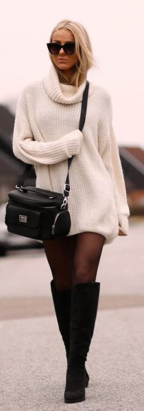 ribbed white sweater dress with black stockings and knee-high boots