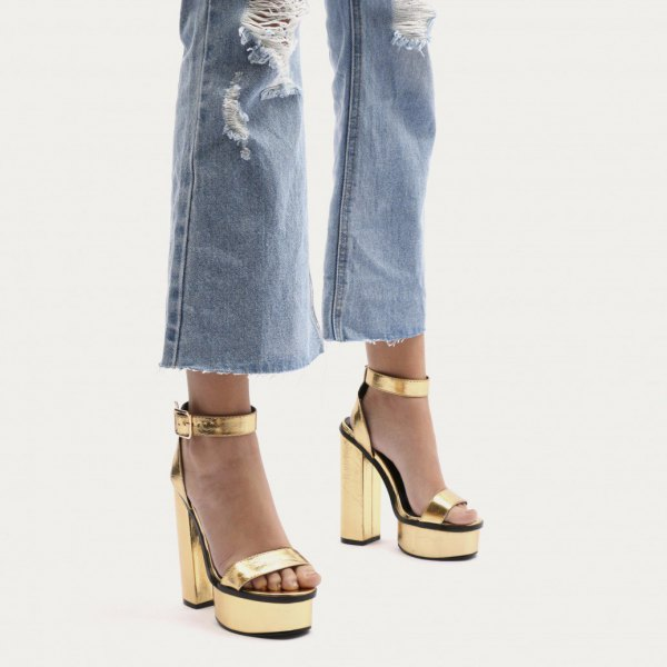 ripped flared jeans with gold platform heels