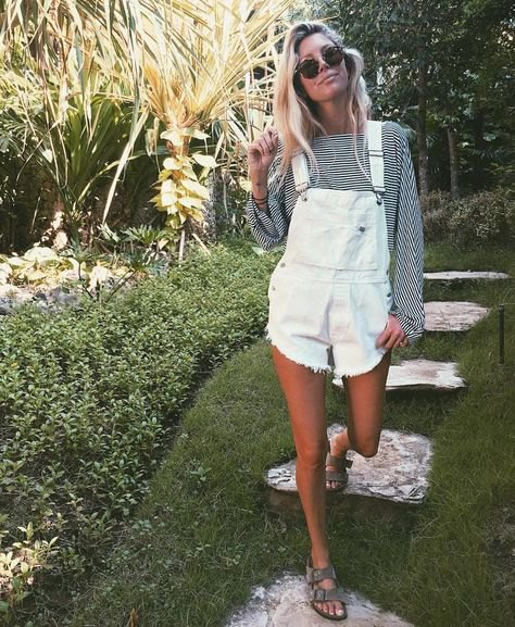 torn overall shorts with black and white striped blouse