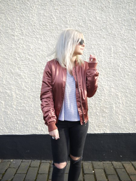 rose gold bomber jacket with striped t-shirt and black jeans