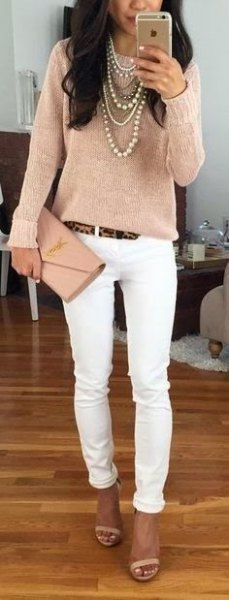 Rose gold long-sleeved top with skinny jeans