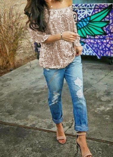 Rose gold sequin blouse with one shoulder and boyfriend jeans