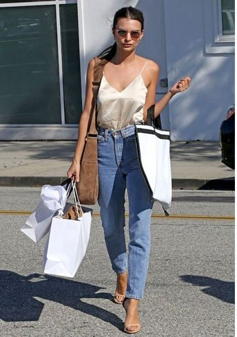 rose gold silk shirt with blue boyfriend jeans and boots