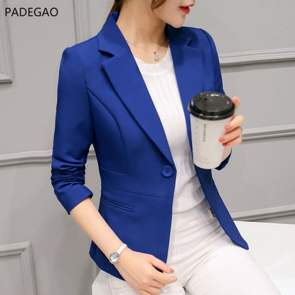 royal blue blazer with white, figure-hugging sweater and matching trousers