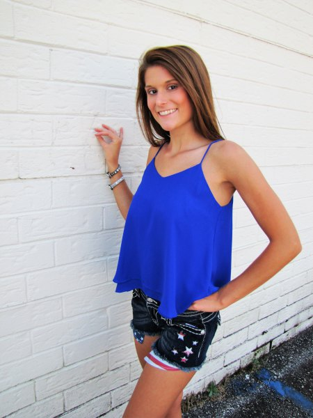 Royal blue, flowing tank top with black embroidered mini denim shorts