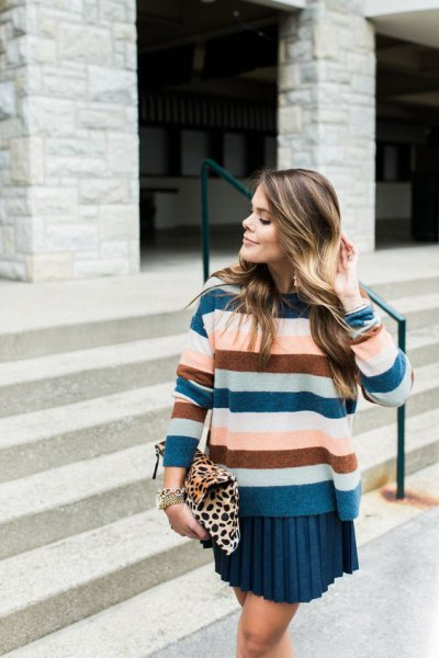 Royal blue, green and pink striped sweater with a pleated mini skirt