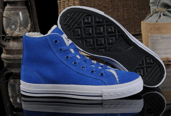 Royal blue high top Converse with white printed t-shirt and jeans