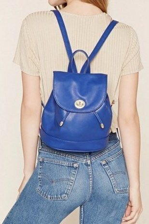 royal blue leather backpack with light pink short-sleeved top