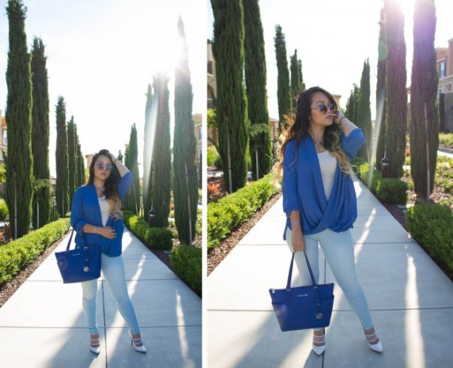 royal blue leather handbag with matching draped top and white jeans