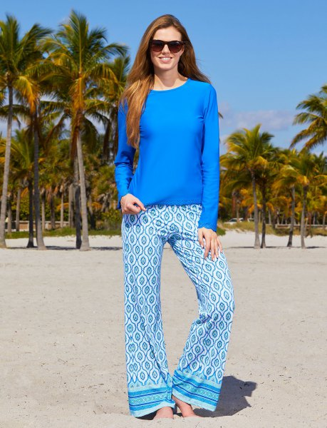 Royal blue long-sleeved top with tribal-printed beach pants with wide legs