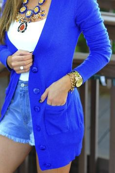 royal blue cardigan with white top and mini denim shorts