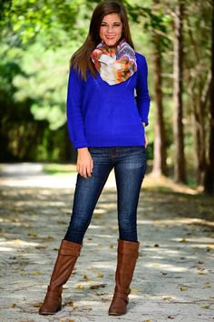 Royal blue sweater with floral printed silk scarf and knee-high boots