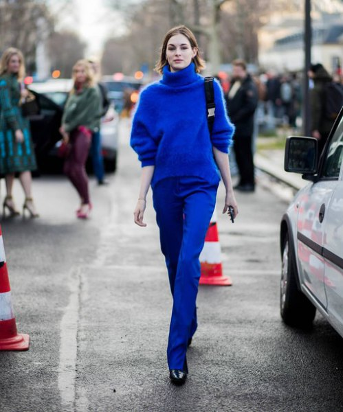 Chunky sweater with a royal blue turtleneck and matching straight leg jeans