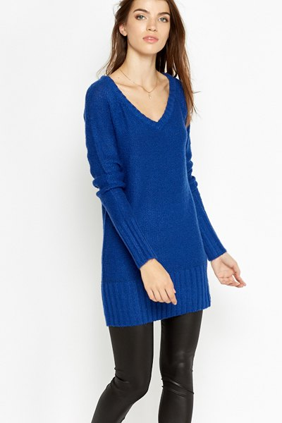 Royal blue tunic sweater with V-neck and black leather gaiters
