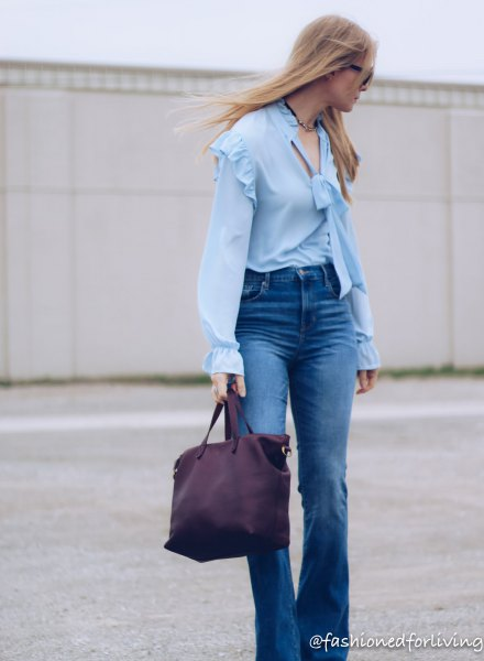 light blue blouse with ruffled shoulder puff sleeves and flared jeans