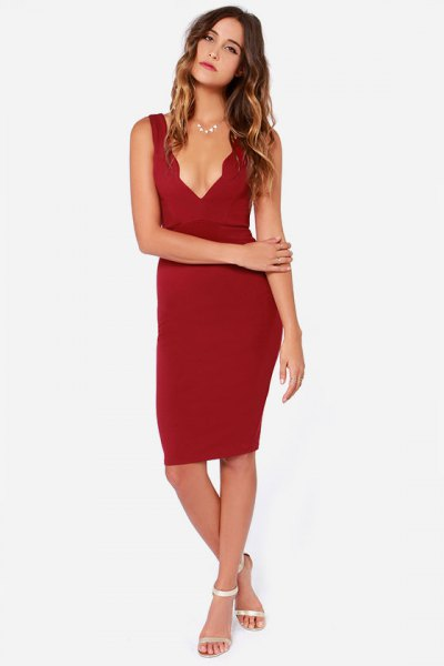 scalloped, deep, figure-hugging dress with V-neckline