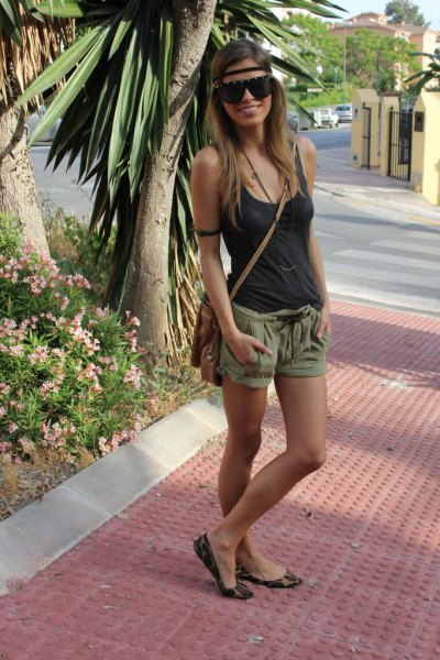 Tank top with scoop neckline and green mini-shorts