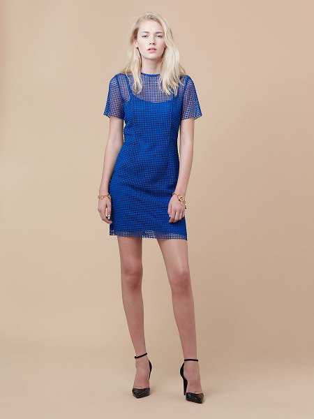 Semi-transparent blue mini sheath dress with pointed toe heels and black ankle strap