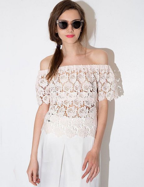 semi-transparent lace top with white linen pants with wide legs