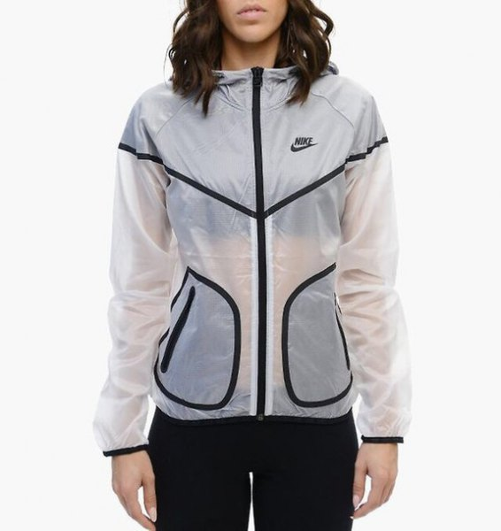semi-transparent white Nike windbreaker with black running shorts