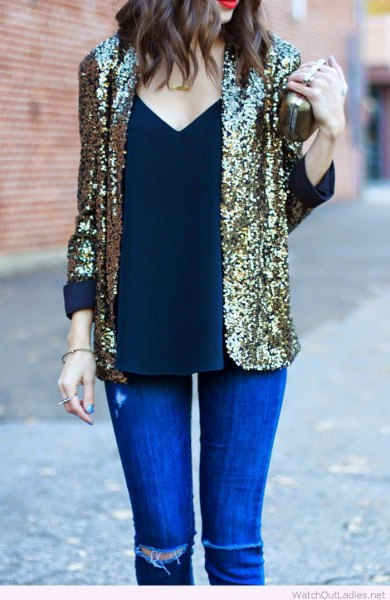 Sequin blazer with deep V-neckline and royal blue skinny jeans