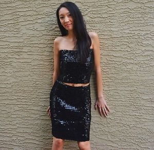 black tube top with sequins and matching knee-length skirt