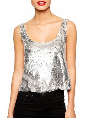 Sequin tank top with a scoop neckline and black skinny jeans