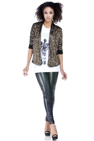 Short sequin jacket with white printed T-shirt and leather gaiters