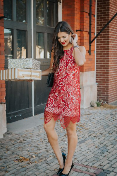 sheer red lace midi dress over a white shift dress