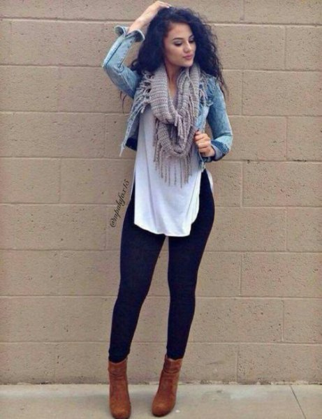short denim jacket with a long white blouse and black leggings