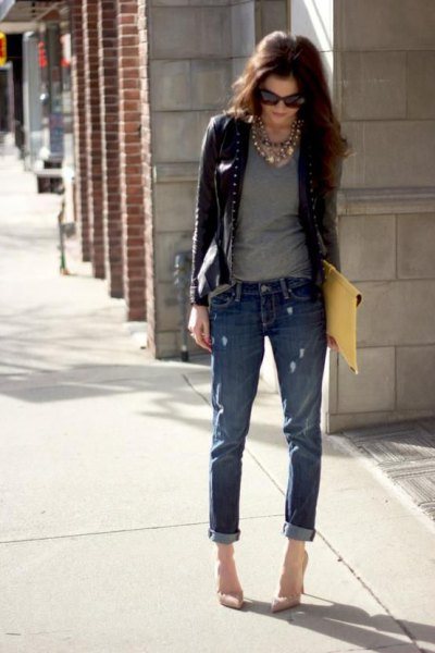 short leather riding jacket with gray T-shirt and cuffed jeans