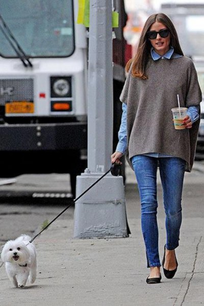 Short-sleeved cape sweater over blue chambray shirt