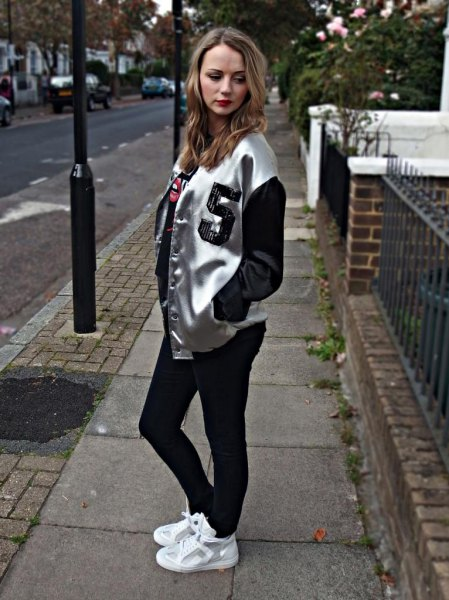 silver and black metallic bomber jacket with white sneakers