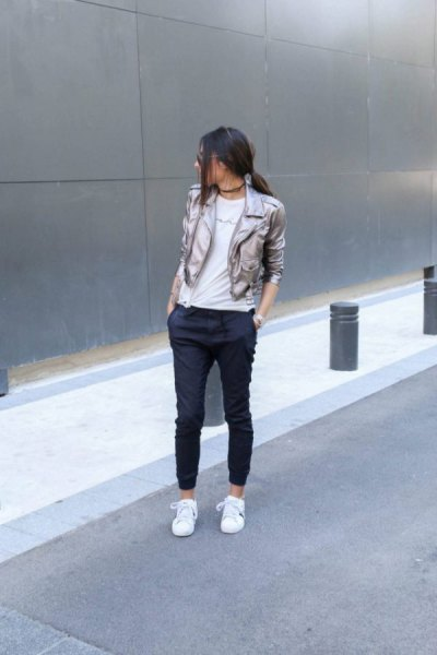 silver blazer with black, cropped jogger jeans and white sneakers