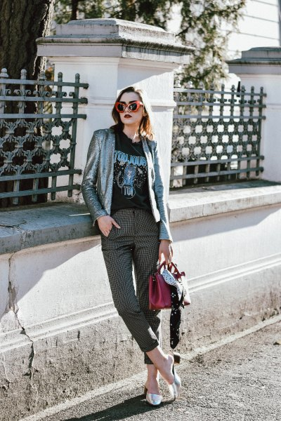 silver blazer with black printed t-shirt and checked, cropped trousers