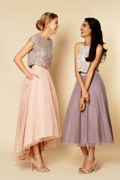 silver top made of sequins with cap sleeves and light pink maxi skirt