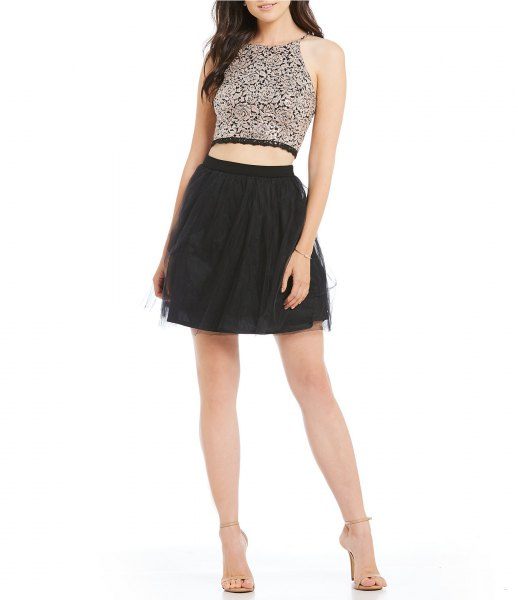 silver, short cut hater top with black minirater skirt