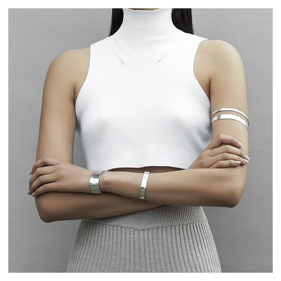Upper arm with silver cuff bracelet