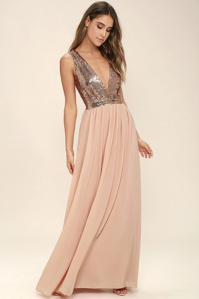 silver sequin top with deep V-neckline and floor-length pleated skirt made of red chiffon