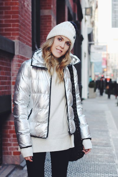 silver down jacket with white knitted sweater