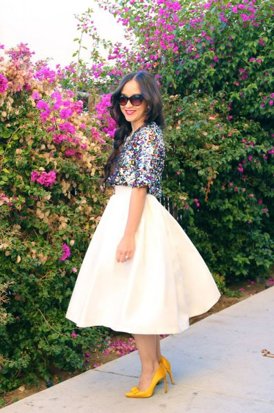 silver sparkling crop top with half sleeves and white, high-waisted midi skirt
