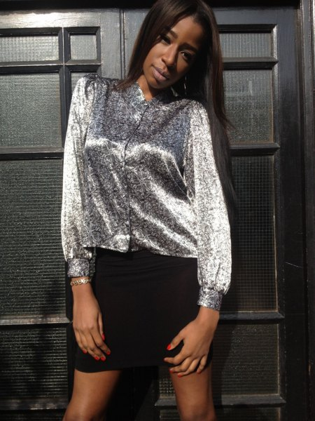 silver metallic blouse with buttons and black mini skirt