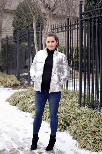 silver down jacket made of metallic with black turtleneck sweater