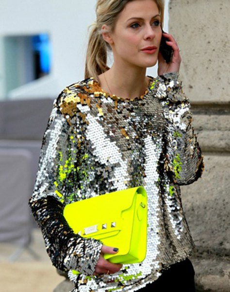 silver metallic sequin long-sleeved blouse with black skinny jeans