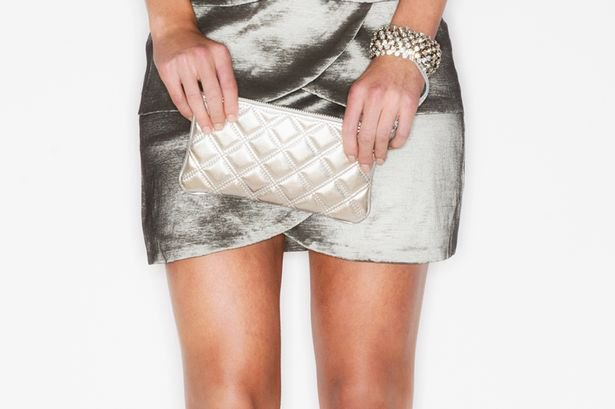 silver mini wrap dress with matching quilted leather handbag